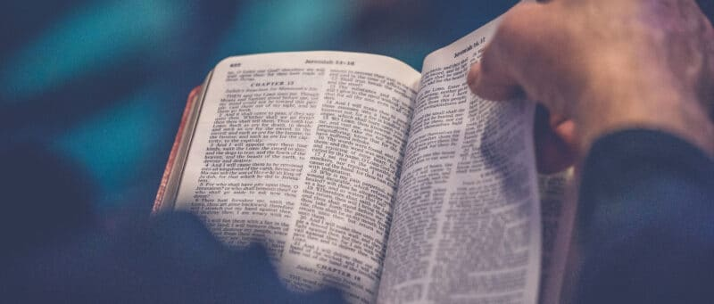turning pages of Bible